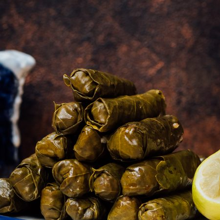 Meatless Stuffed Grape Leaves packed with Mediterranean flavours and spices are so darn good! Don't worry if you have never made these stuffed leaf logs before. We've made a how to video for you!
