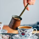 How to make Turkish coffee in a copper coffee pot and serving it in traditional small cups