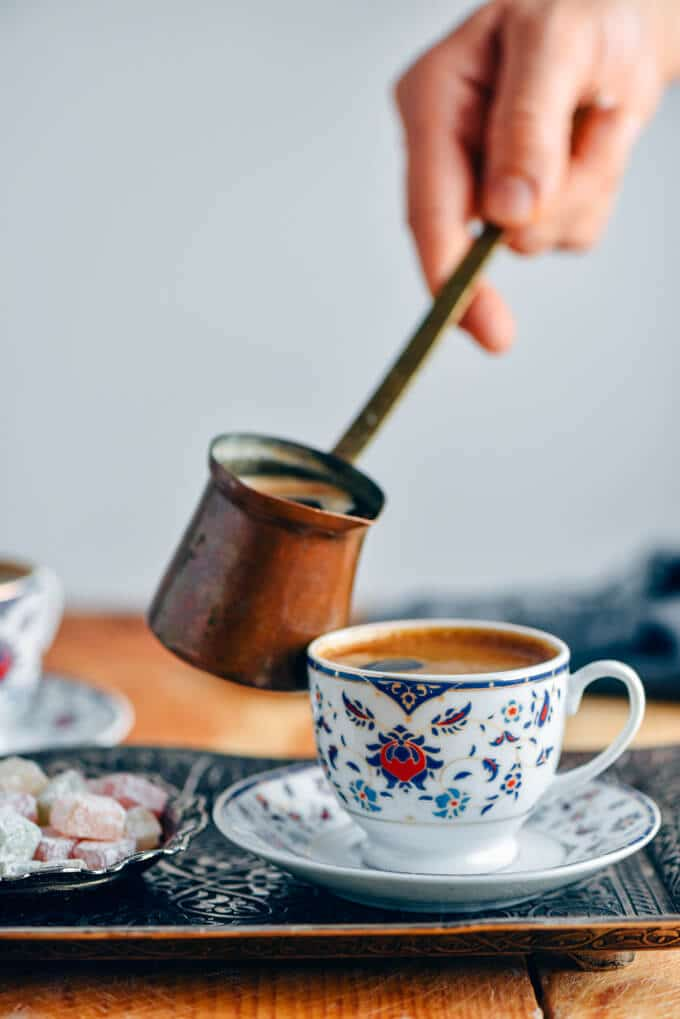 How to make Turkish coffee in a copper turkish coffee pot and serving it in traditional small cups