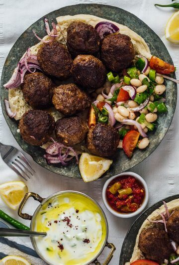 Homemade Turkish Meatballs served with bean salad and cucumber dip