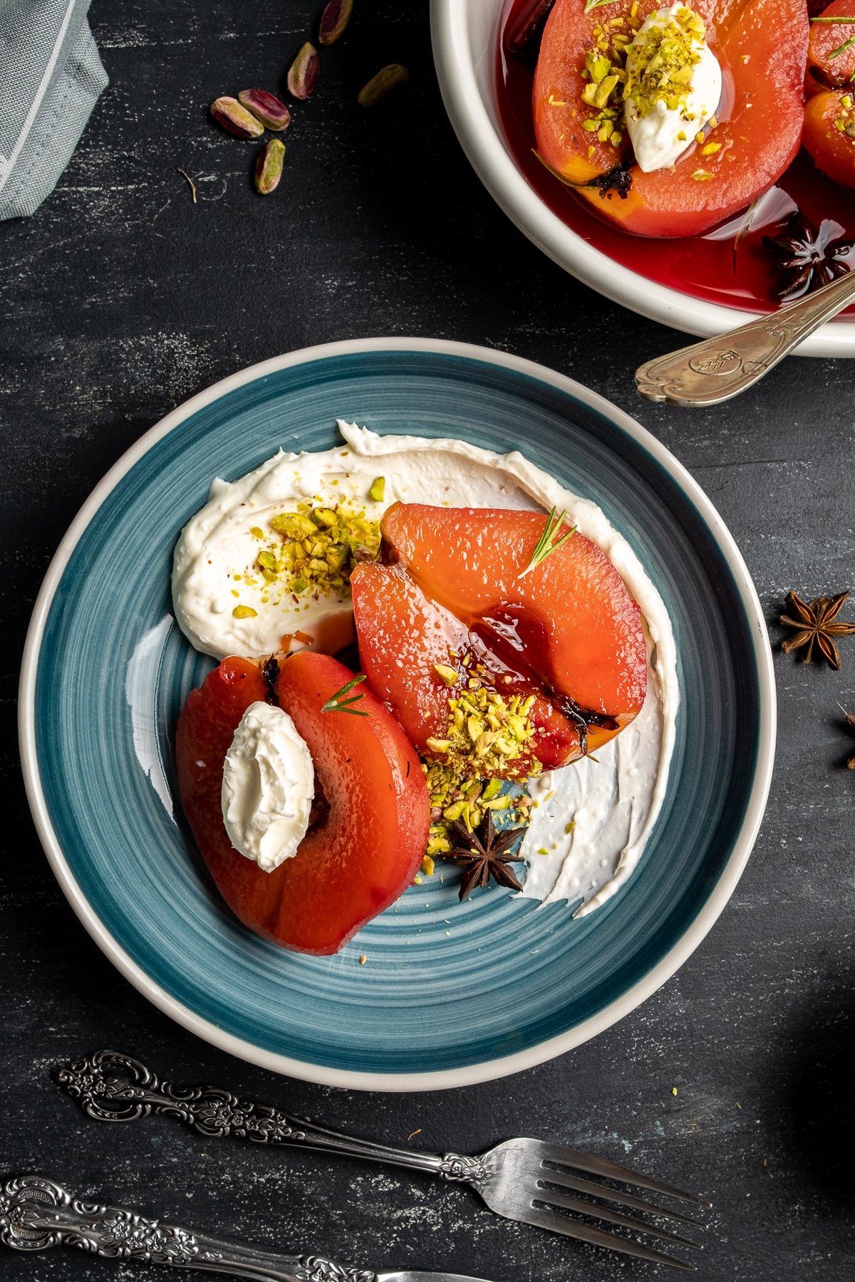 Turkish style quince dessert served with pistachio and clotted cream on a plate.