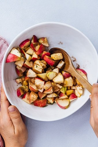 spiced apples in a white bowl