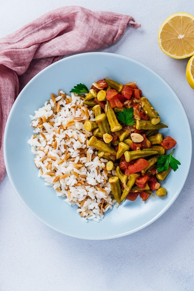 Stewed okra and tomatoes served with rice in a blue bowl