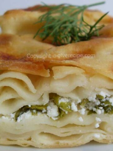 A slice of Turkish water borek stuffed with feta and parsley.