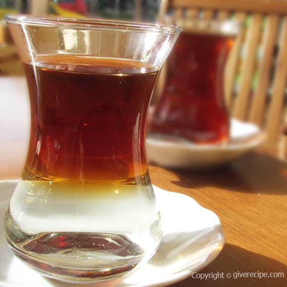 An Enigmatic Turkish Tea. A two colored tea; transparent on the bottom and reddish on the surface. Looks like black tea floats over plain water.