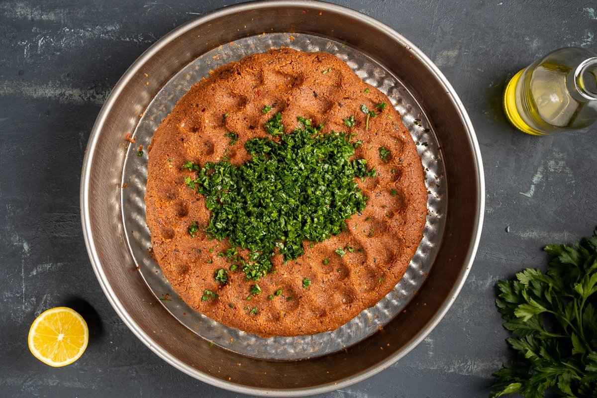 Fine bulgur mixture with parsley in a traditional cig kofte tray.
