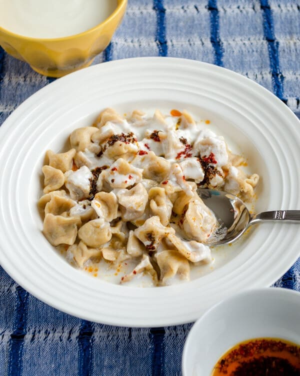 Turkish Dumplings Manti with yogurt in a white bowl