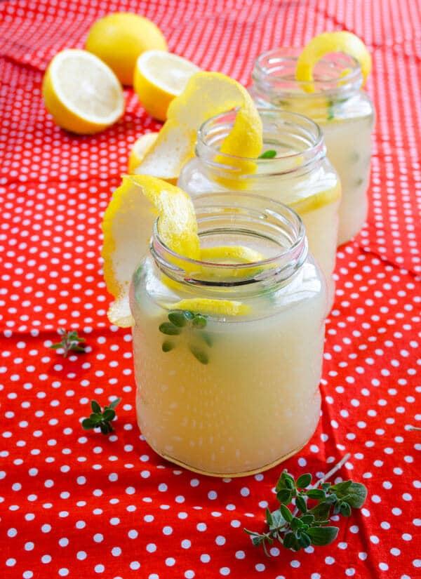 Homemade lemonade with lemon juice in small jars