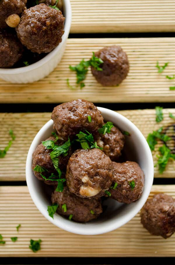 Cheese stuffed meatballs coated with honey and pomegranate molasses