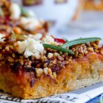 Hot pepper pizza with sesame seeds and onions