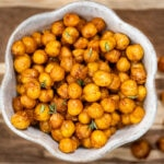 Baked chickpeas with spices in a white bowl.