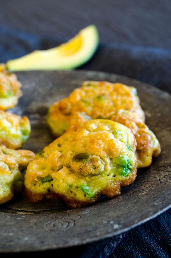 Avocado corn fritters on a copper plate