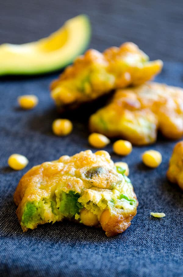 Gluten-free avocado corn fritters on grey linen