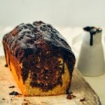Marbled Chocolate Banana Bread topped with a silky chocolate ganache gives you the feeling of an amazingly light and moist chocolate cake. If you love chocolate and banana flavors together, you will LOVE this! Decadent and easy to make!
