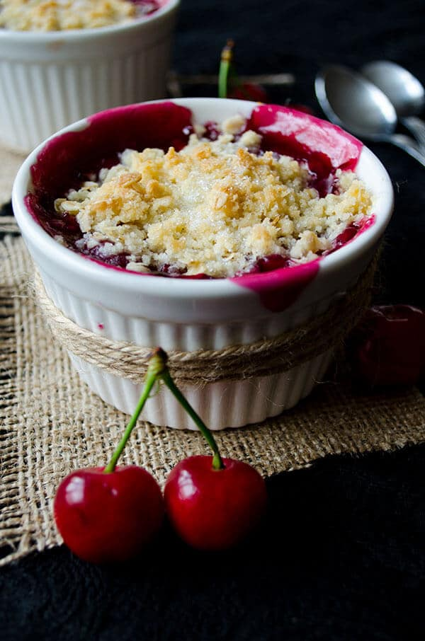 Fresh Cherry Crisp in white ramekins