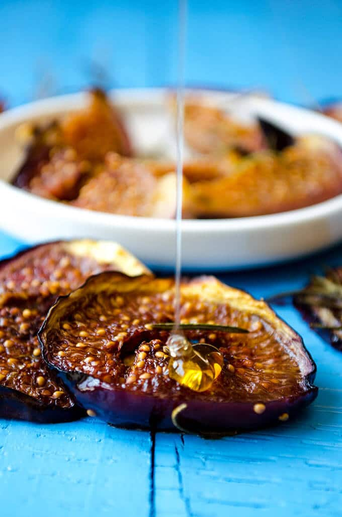 Drizzling honey on baked figs