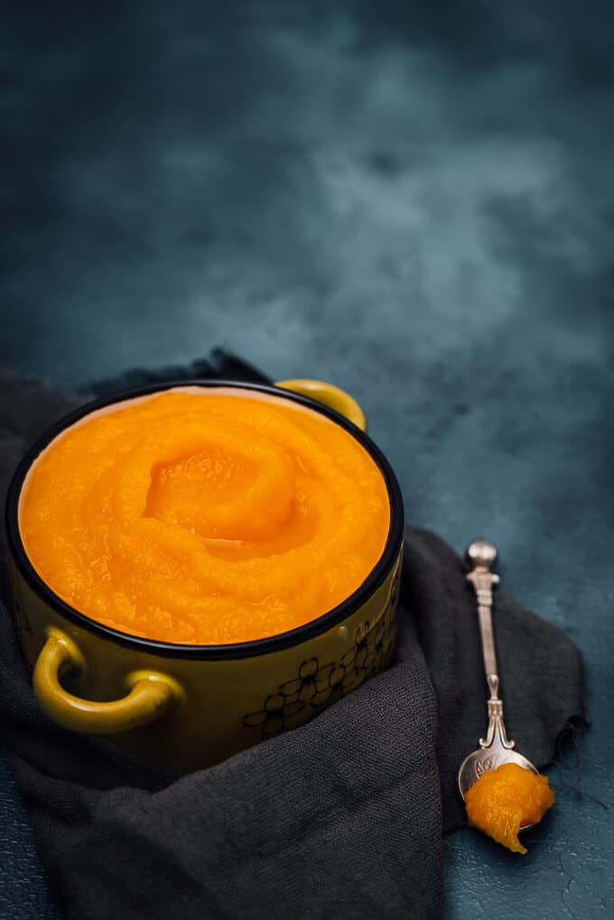 Homemade Fresh Pumpkin Puree is the easiest homemade thing ever! You won't buy any canned puree after you see you can make it at home. Freeze it in zip bags and use it in your favourite pumpkin recipes all year round.