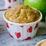 Zucchini Cinnamon Apple Muffins in muffin liners with heart shapes