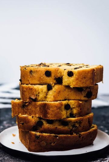 Pumpkin chocolate chip bread slices stacked on a plate