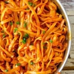 Fettuccine recipe with creamy tomato sauce and parmesan in a pan.