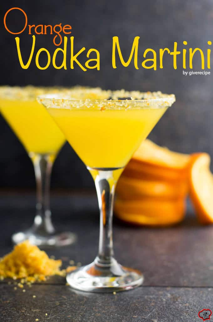 Vodka orange juice martini in martini glasses rimmed with orange zest and sugar.