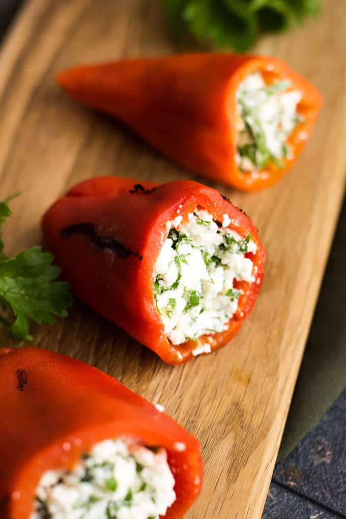 Feta Stuffed Red Bell Peppers make perfect appetizers for parties. Roasted red bell peppers are filled with a mixture of feta and greek yogurt. - giverecipe.com