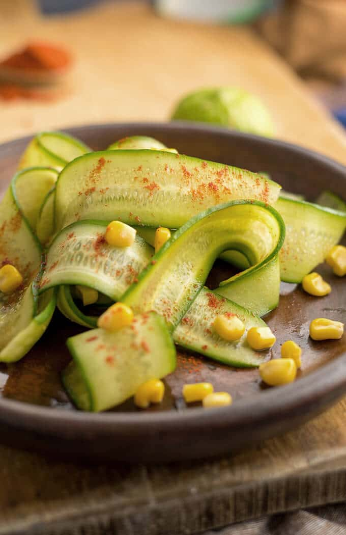Mexican Cucumber Salad with lime, new Mexican chile powder and corn. - giverecipe.com