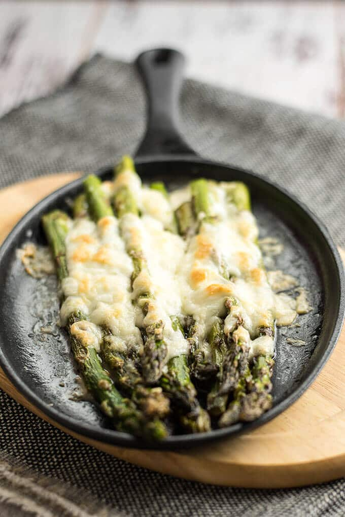 Roasted Asparagus with Mozzarella can tempt anyone. This is always the winner at parties. Simple yet addictive! - giverecipe.com