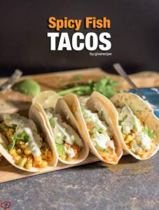 Spicy Fish Tacos loaded with corn salsa, topped with an addictive tzatziki sauce. Create the world's yummiest dinner in a few minutes! -giverecipe.com