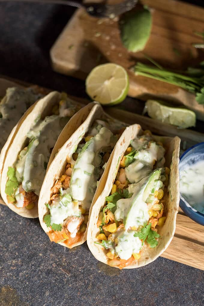 Spicy Fish Tacos loaded with corn salsa, topped with an addictive ...
