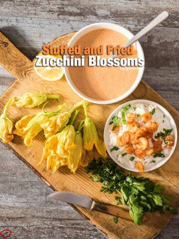 Zucchini blossoms stuffed with cooked shrimps and cheese. Battered and deep fried. These are TO DIE FOR! Disappear in a minute! - giverecipe.com