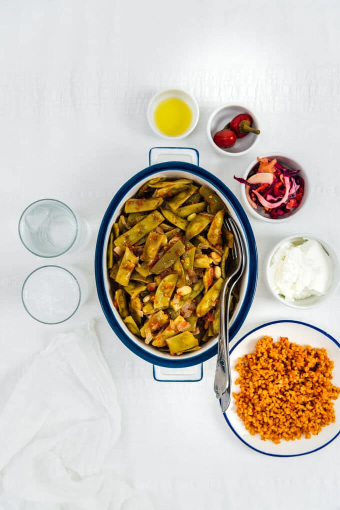 Braised Green Beans with Tomatoes is a tasty Turkish style vegetarian recipe. It is an outstanding combination of simple ingredients. Just use good olive oil for this.