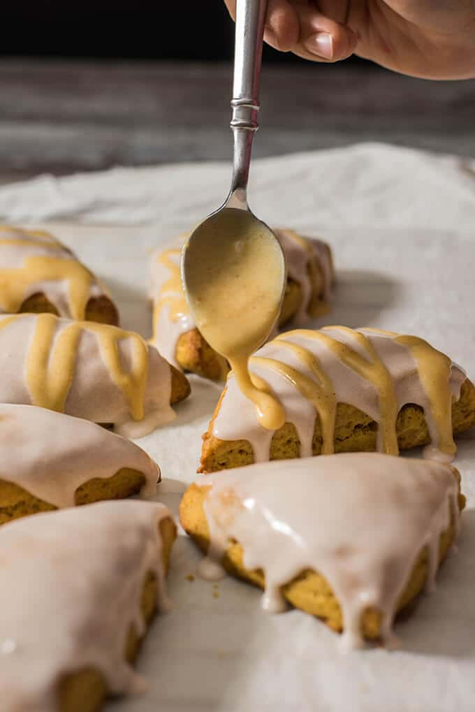 Double-Glazed Pumpkin Scones are inspired by Starbucks' spiced pumpkin scones. Light and fluffy with a subtle pumpkin flavor. Perfect for any holiday in fall! - giverecipe.com