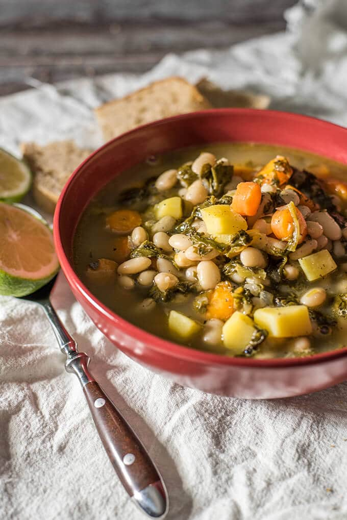 Tuscan Bean Soup is the best comforting meal on chilly days. A vegan recipe and amazingly flavorsome as it is loaded with wonderful vegetables. Ready in 30 min! - giverecipe.com