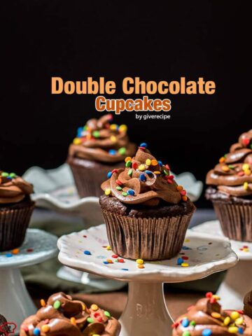 Double chocolate cupcakes. The cake is wonderfully moist and fluffy and topped with a perfect chocolate buttercream frosting. This recipe is absolutely the game changer and will become your ultimate chocolate cupcake recipe.