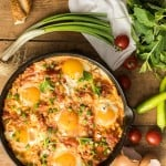 Turkish omelette menemen with tomatoes and peppers in a pan
