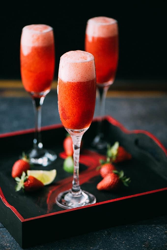 Strawberry champagne in flute glasses