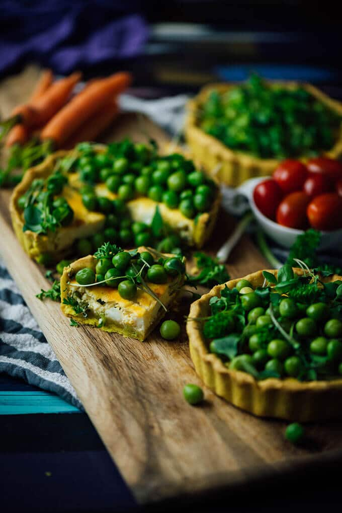 Peas and Herbs Cheese Tarts bring spring to your kitchen. I promise you have never eaten such a tasty savory tart before!