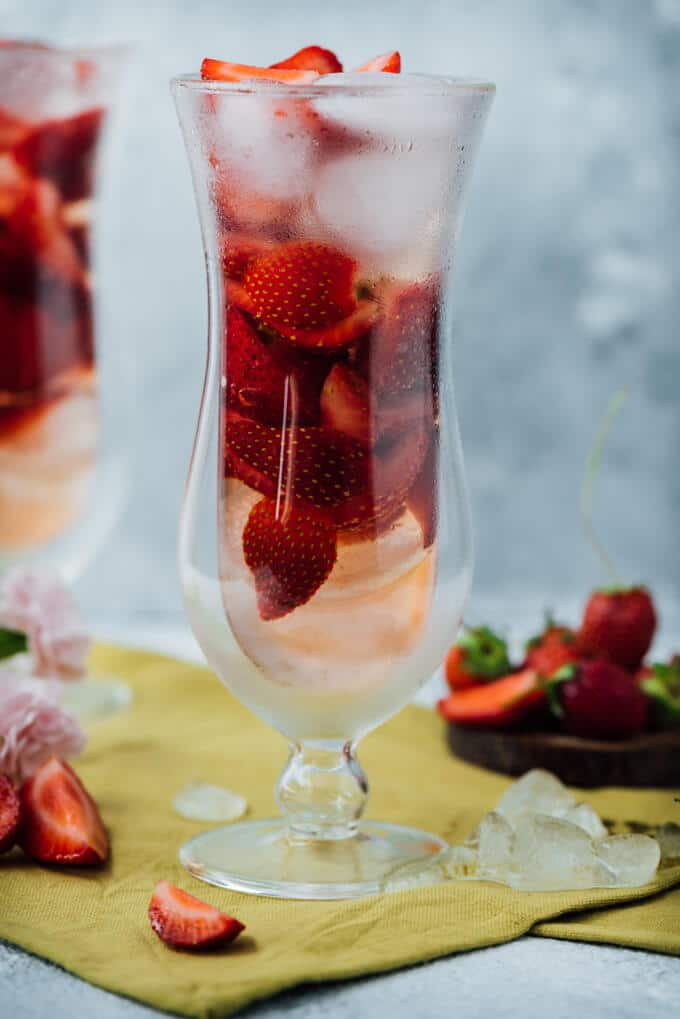 Green Tea Strawberry Sangria will be the new hit at your weekend parties. The green tea twist adds an extra refreshment to the simple strawberry sangria.