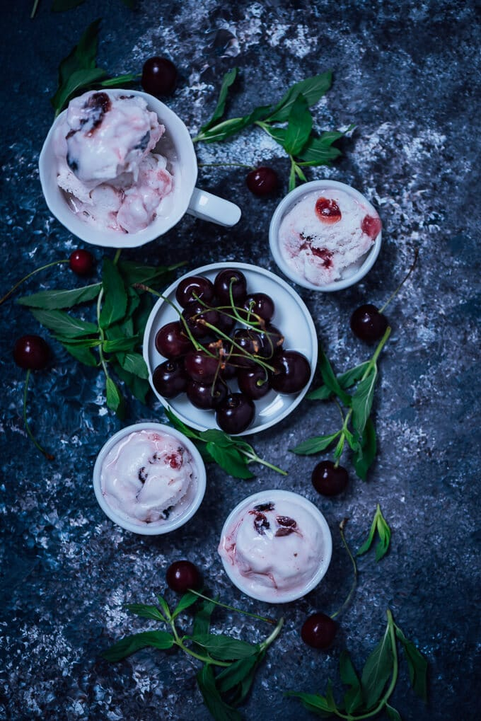 This No-Churn Fresh Cherry Ice Cream is a perfect summer desert and super simple to make. A basic vanilla ice cream is enriched with fresh cherries and turns into a new recipe that is slighly tangy and chunky.