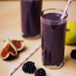 Blackberry Fig Kefir Smoothie in tall glasses with white and pink straws