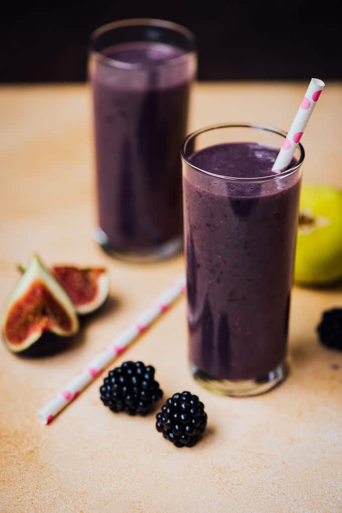 Blackberry Fig Kefir Smoothie in two glasses with white and pink straws