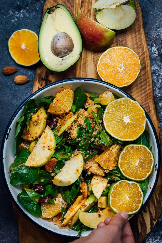 Quinoa black bean salad with arugula, avocado, apples and oranges