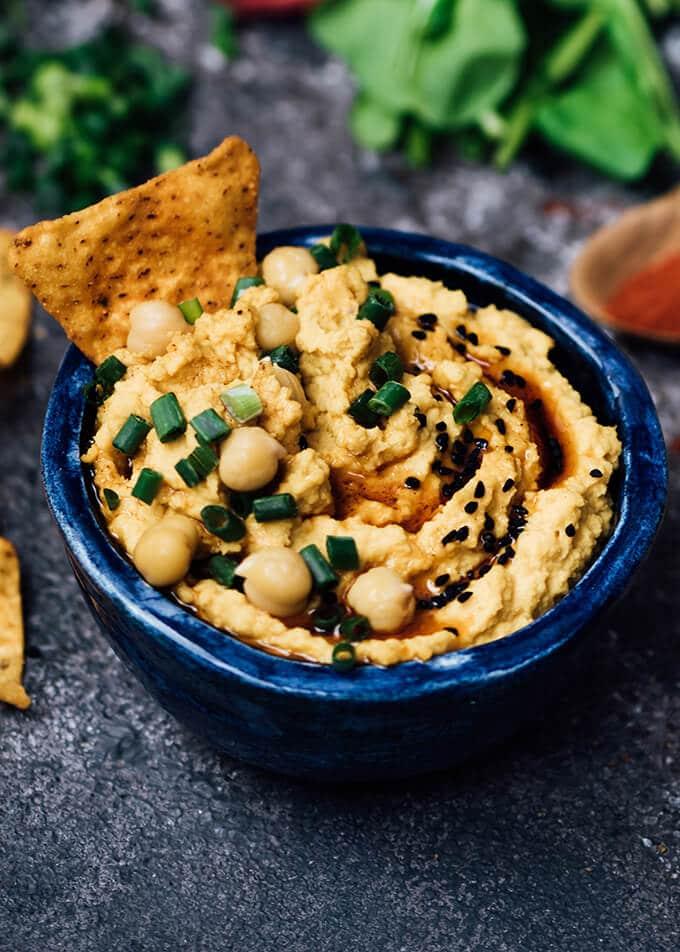 Spicy Pumpkin Hummus in a blue bowl.