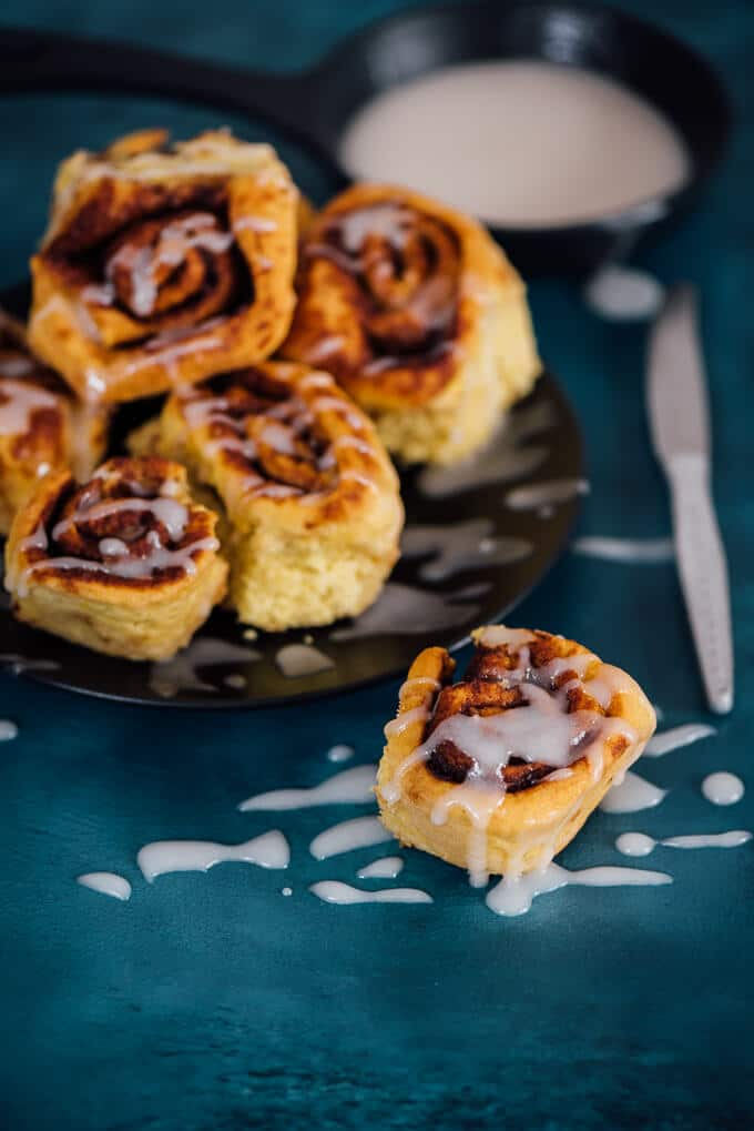 Pumpkin Cinnamon Rolls with Vanilla Glaze are perfectly fluffy and buttery. The dough with a subtle pumpkin flavor matches very well with the cinnamon and nutmeg sugar filling.