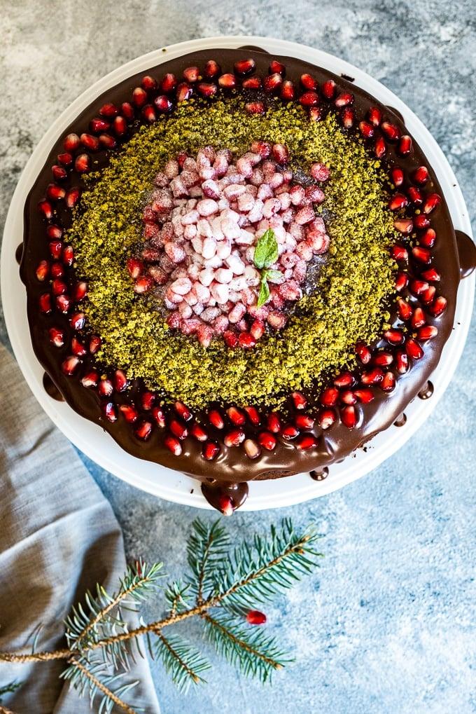 Chocolate cake for Christmas on a cake stand.