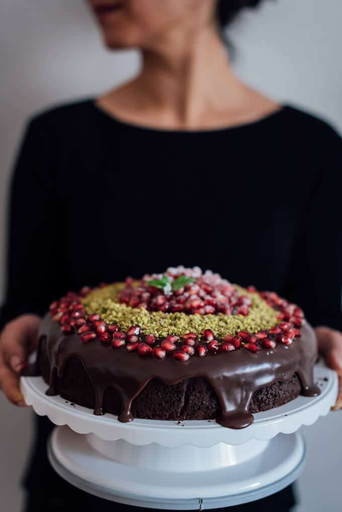 Greek Yogurt Chocolate Cake has to take its place on your Christmas table. Super easy yet decadent with a perfect pomegranate decoration.