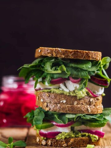 Feta Cheese Sandwich with herbs, avocado and pickled red onions.