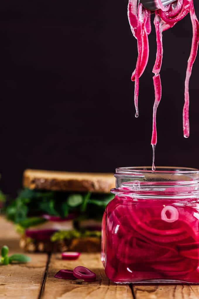 Homemade quick red onion pickles in a jar