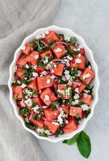 Watermelon Feta Mint Salad with red onion is a super refreshing summertime recipe. The simple balsamic dressing in this unexpected combination of flavors takes the salad to the next level.